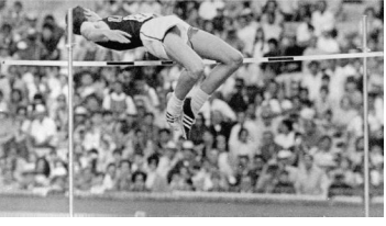 Dick Fosbury back first over the bar